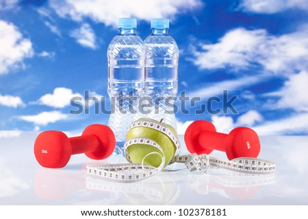 fitness dumbbells, water and apple - stock photo