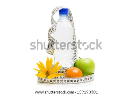 fitness equipment and healthy food isolated on white (bottle of water, green apple, tangerine and measuring tape) - stock photo