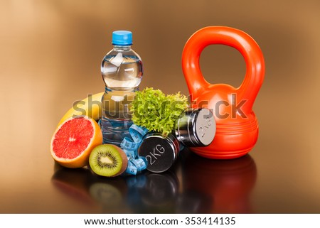 fitness equipment and healthy food on black surface