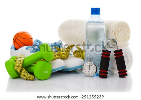 fitness equipment isolated on white (towel, two green dumbbells, shoes, ball, stopwatch, simulator for hand and bottle of water) - stock photo