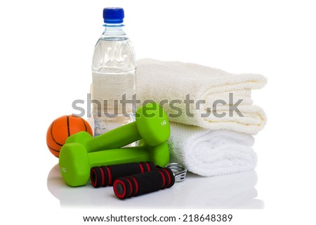 fitness equipment isolated on white (towel, two green dumbbells, simulator for hand, ball and bottle of water)