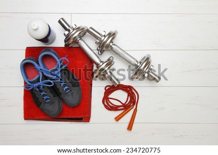 fitness equipment on white wooden plank floor - stock photo