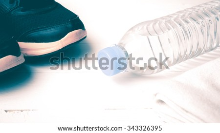 fitness equipment:running shoes,water bottle,towel vintage style