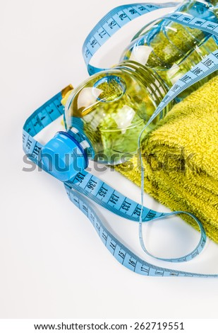 Fitness equipment towel and bottle of water composition - stock photo
