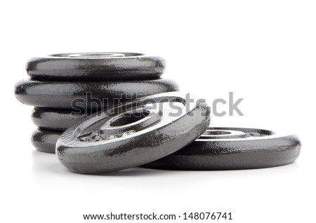 Fitness exercise equipment dumbbell weights on white background. - stock photo