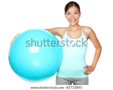 Fitness exercise woman holding pilates ball ready for exercising. - stock photo