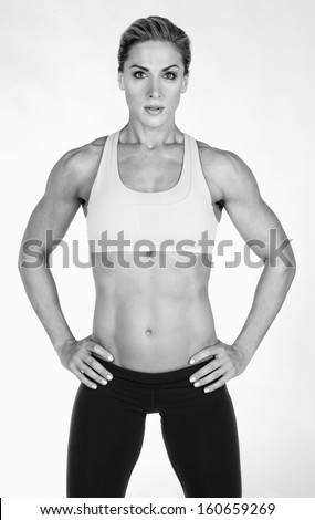 Fitness - Female Body builder - stock photo