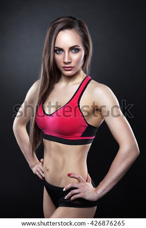 Fitness female looking at camera - stock photo