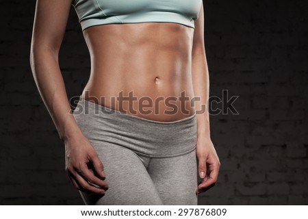 Fitness female woman with muscular body, do her workout, abs, abdominal - stock photo