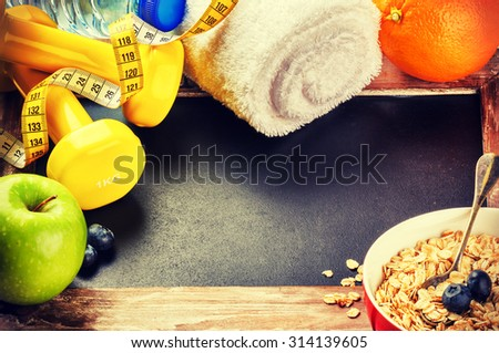 Fitness frame with dumbbells and fresh fruits. Healthy lifestyle concept with copy space - stock photo