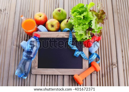 fitness frame with dumbbells and fruits copy space - beauty and sport - stock photo