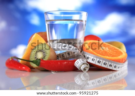 fitness gear, water and fruits - stock photo