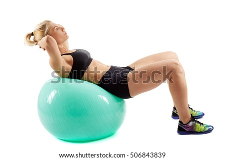 Fitness girl doing abs with elastic ball on white background
