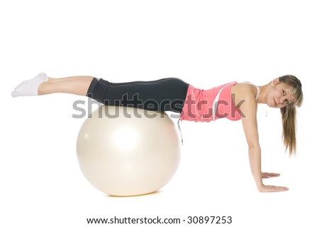 Fitness girl doing pilates with a ball. Isolated on white