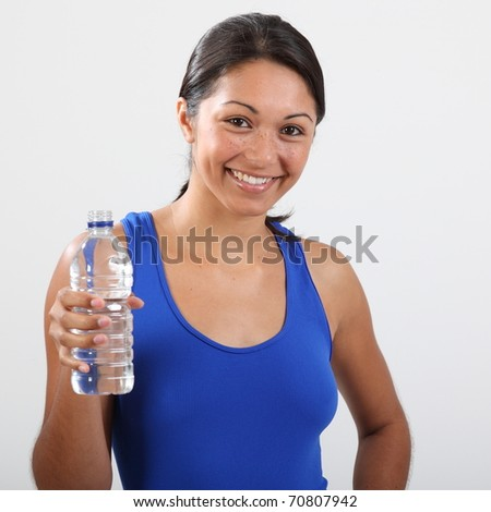 Fitness girl enjoys water after a work out