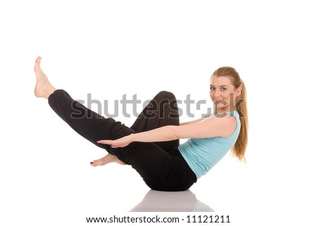 Fitness girl exercising on floor. - stock photo