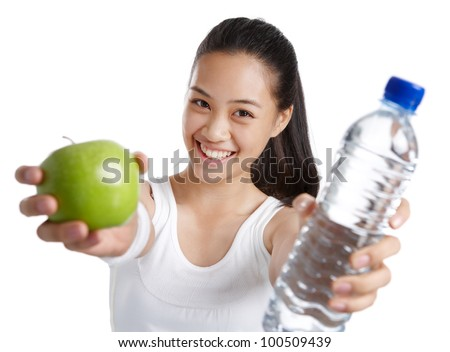 fitness girl holding green apple and water bottle - stock photo