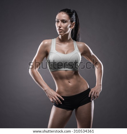Fitness girl on a dark background - stock photo