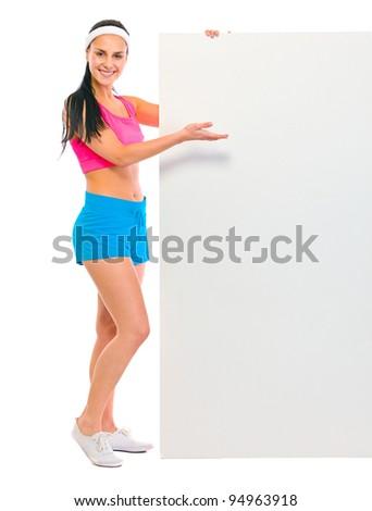 Fitness girl showing blank billboard - stock photo