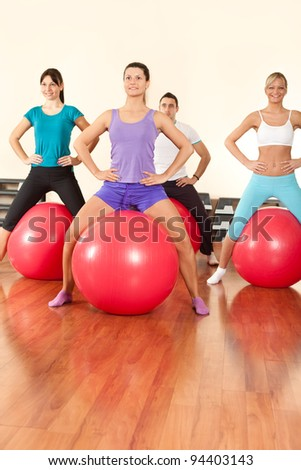 fitness group doing exercises for legs  with fitness ball - stock photo