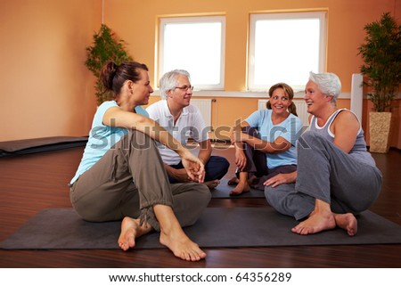 Fitness group having small talk in a gym - stock photo