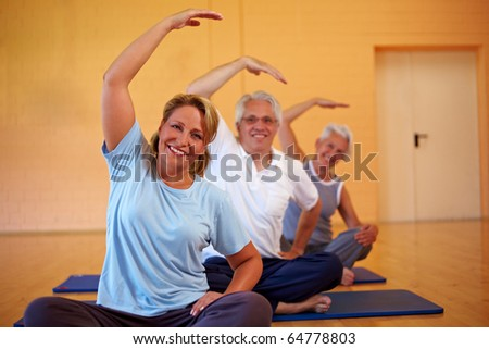 Fitness group in gym doing back exercises - stock photo