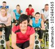 Fitness group of people on bicycle - stock photo