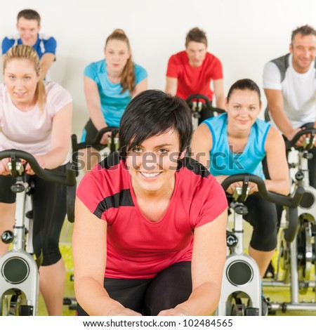 Fitness group of people on bicycle