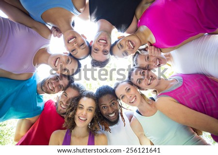 Fitness group smiling at camera in park on a sunny day