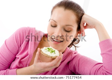 Fitness happy woman eat snack sportive outfit in gym - stock photo