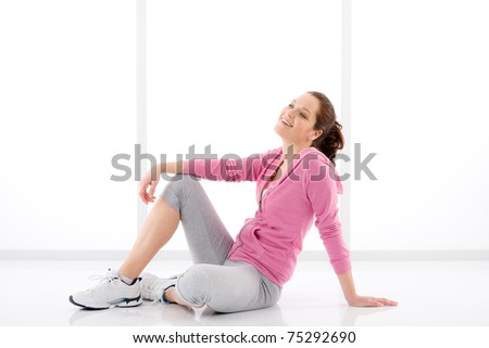 Fitness happy woman in sportive outfit on white - stock photo