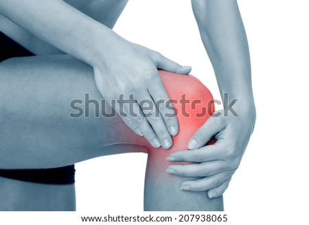 fitness, healthcare and medicine concept - close up of female hands holding knee - stock photo