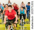 Fitness instructor leading class people exercise enjoy physical workout - stock photo
