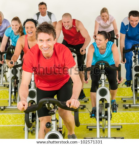 Fitness instructor leading class people exercise enjoy physical workout