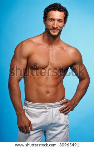 Fitness Instructor over blue background - stock photo
