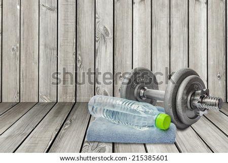 fitness instrument include dumbbell, towel and a bottle of water - stock photo