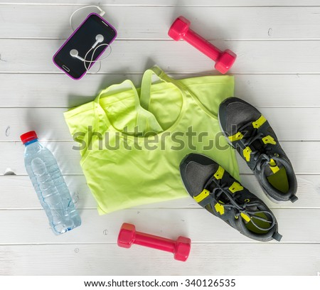 fitness items on wooden planks background top view