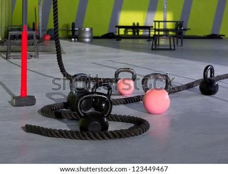 Fitness Kettlebells ropes and hammer gym with lifting bars and wall balls