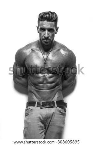fitness male bodybuilder wearing jeans on white - stock photo