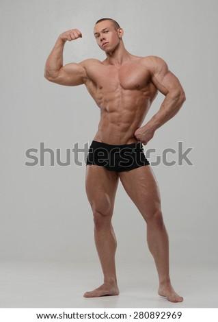 Fitness male model in studio - stock photo