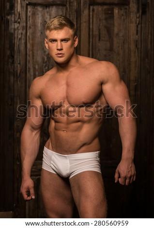 Fitness male model Sergei Mironov - stock photo