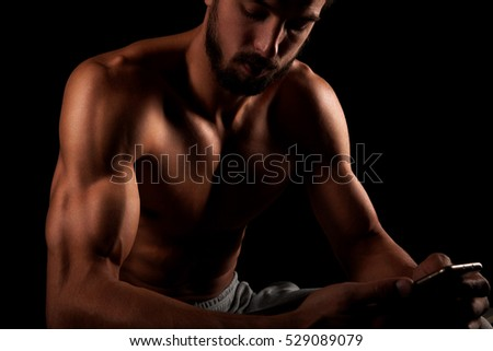 Fitness male model showing triceps muscle