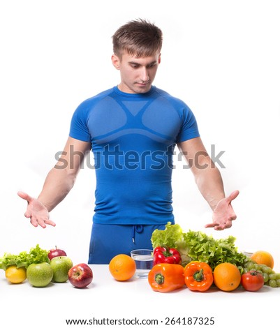 fitness male trainer. Cheerful muscular man sitting with healthy food - stock photo