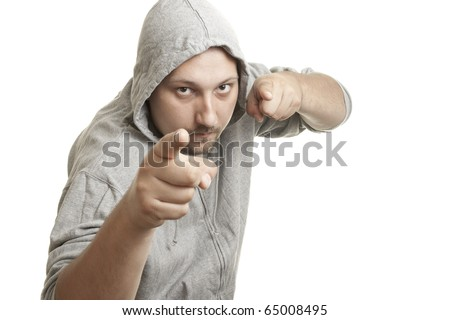 Fitness man in a T-shirt with hood pointing fingers at you - stock photo
