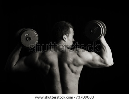 Fitness man lifting weights - stock photo