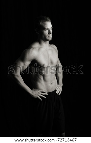 Fitness man, low key - stock photo