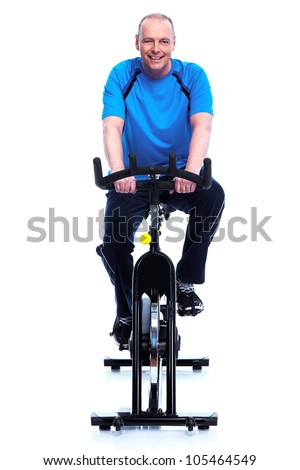 Fitness man on bike. Isolated on white background. - stock photo