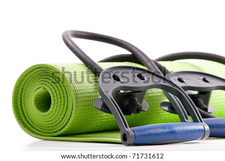 Fitness Mat and Resistance Bands - stock photo