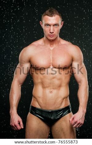 Fitness model posing in aqua studio - stock photo