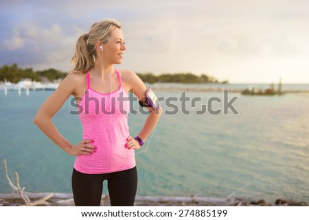 Fitness model standing outdoors in early morning - stock photo